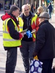 Two SNP campaigners talking to older man during Dr Philippa Whitford's Central Ayrshire campaign in Irvine, Saturday 21st February 2015