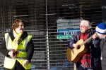 Dr Philippa Whitford laughing with busker during Central Ayrshire campaign in Irvine, Saturday 21st February 2015