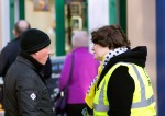 Dr Philippa Whitford talking to man during Central Ayrshire campaign in Irvine, Saturday 21st February 2015