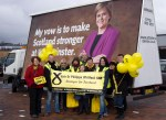 Dr Philippa Whitford with SNP campaign team alongside the SNP Campaign Ad Trailer in Irvine