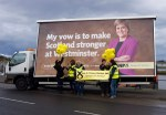 Part of the local SNP team for the constituency prparing for group photograph in front of SNP Ad Trailer in Irvine