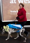 Dr Philippa Whitford walking the SNP dog beside the Ad Trailer in Irvine