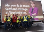 Dr Philippa Whitford standing with local SNP supporters beside the SNP Ad Trailer in Prestwick