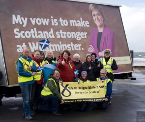 Dr Philippa Whitford standing with local SNP supporters beside the SNP Ad Trailer in Troon