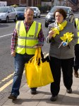 Dr Philippa Whitford walking with team member in Prestwick