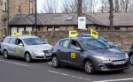 Two SNP bedecked cars parked in Prestwick