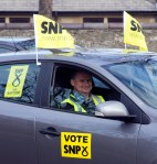 SNP supporter in SNP bedecked car parked in Prestwick