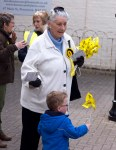 Adult and child with SNP merchandise in Prestwick