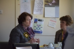 Dr Philippa Whitford talking with voters in café