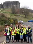Philippa with part of the canvassing team with Dundonald Castle in background