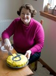 Philippa cutting a much appreciated donated SNP cake in Dundonald