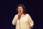 Elaine C Smith performing on stage at Philippa Whitford's SNP fundraising event