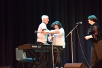 Book Winner on stage to collect his prize from Elaine C Smith and Philippa Whitford