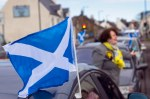Saltire flag on cavalcade car in Monkton with Philippa Whitford in background