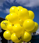 a bunch of yellow SNP balloons