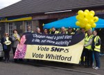 SNP team holding vote Dr Philippa Whitford banner in Dundonald